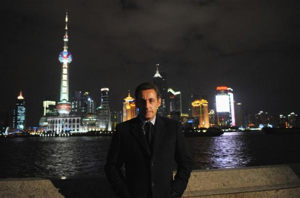 France's President Nicolas Sarkozy poses on the Bund in Shanghai on the last day of his three-day official visit to China November 27, 2007.