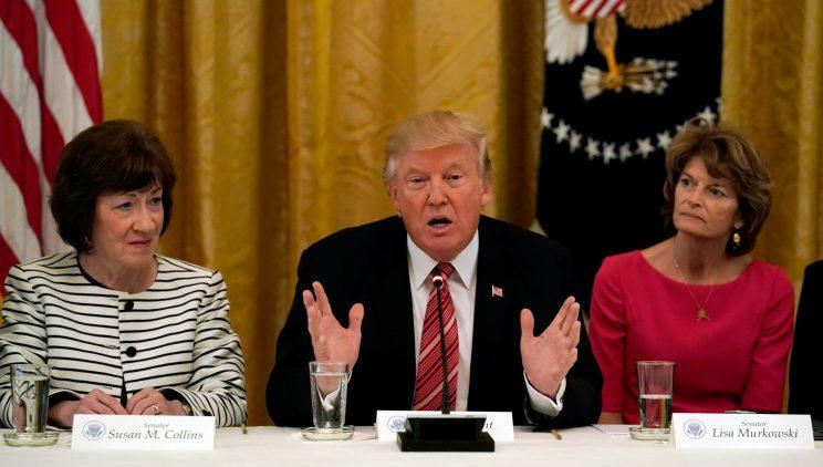 Sen. Susan Collins, left, and Sen. Lisa Murkowski sitting next to President Trump at a health care roundtable Tuesday. (Photo: Kevin Lamarque/Reuters)