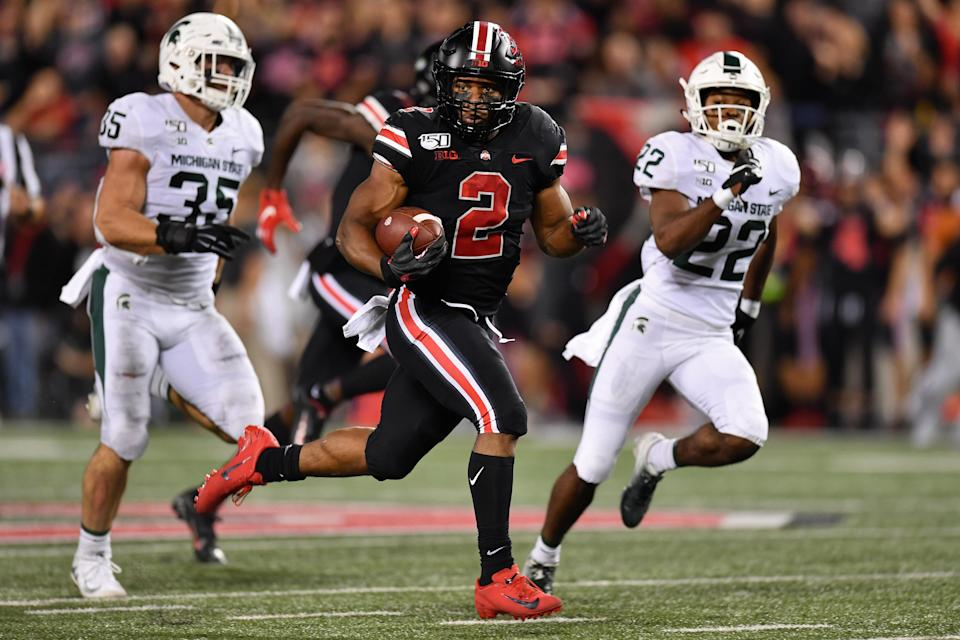 J.K. Dobbins #2 of the Ohio State Buckeyes takes off on a 67-yard touchdown run in the second quarter of his team's win over the Michigan State Spartans. (Getty)