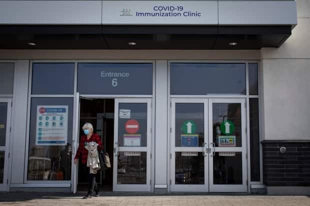 Ontarians aged 75 and up, some accompanied by relatives and caregivers, attend a COVID-19 mass vaccination clinic at the East York Town Centre mall, in Toronto's Thorncliffe Park neighbourhood, on March 24, 2021.