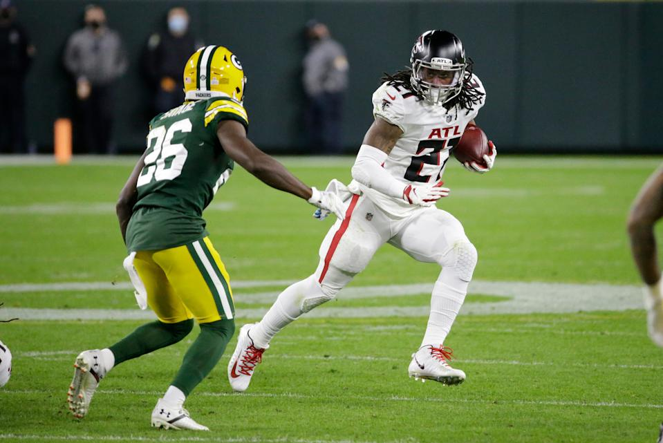 Atlanta Falcons' Todd Gurley (21) runs against Green Bay Packers' Darnell Savage (26) during the second half of an NFL football game, Monday, Oct. 5, 2020, in Green Bay, Wis. (AP Photo/Mike Roemer)