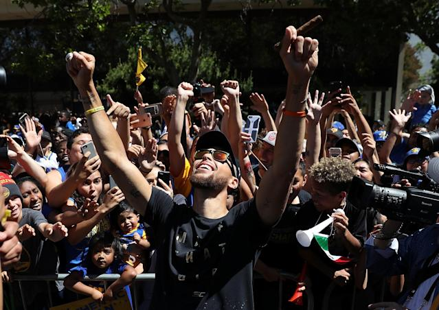 <p>Golden State Warriors Stephen Curry celebrates with fans during the Warriors Victory Parade on June 15, 2017 in Oakland, California. An estimated crowd of over 1 million people came out to cheer on the Golden State Warriors during their victory parade after winning the 2017 NBA Championship. (Photo by Justin Sullivan/Getty Images) </p>