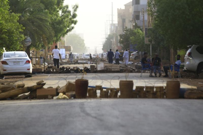 Protesters have blocked streets in Sudan's capital to to keep out military vehicles after a deadly crackdown by paramilitaries on a sit-in (AFP Photo/-)