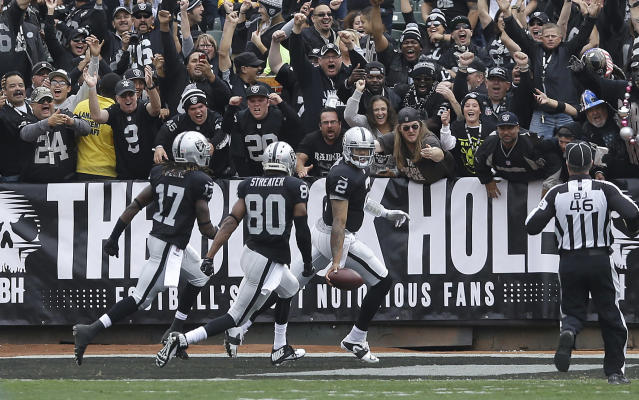 Oakland Raiders quarterback Terrelle Pryor (2) celebrates with wide receiver Denarius Moore (17) and wide receiver Rod Streater (80) after running for a 93-yard touchdown against the Pittsburgh Steelers during the first quarter of an NFL football game in Oakland, Calif., Sunday, Oct. 27, 2013. (AP Photo/Jeff Chiu)
