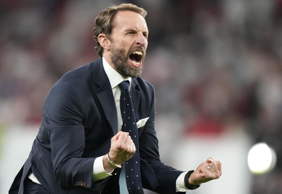 England's manager Gareth Southgate celebrates after winning during the Euro 2020 soccer championship semifinal match between England and Denmark at Wembley stadium in London, Wednesday,July 7, 2021. (AP Photo/Frank Augstein,Pool)