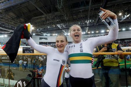 Cycling - UCI Track World Championships - Women's Sprint, Final - Hong Kong, China - 14/4/17 - Germany's Kristina Vogel (L) celebrates with Australia's Stephanie Morton after winning gold. REUTERS/Bobby Yip