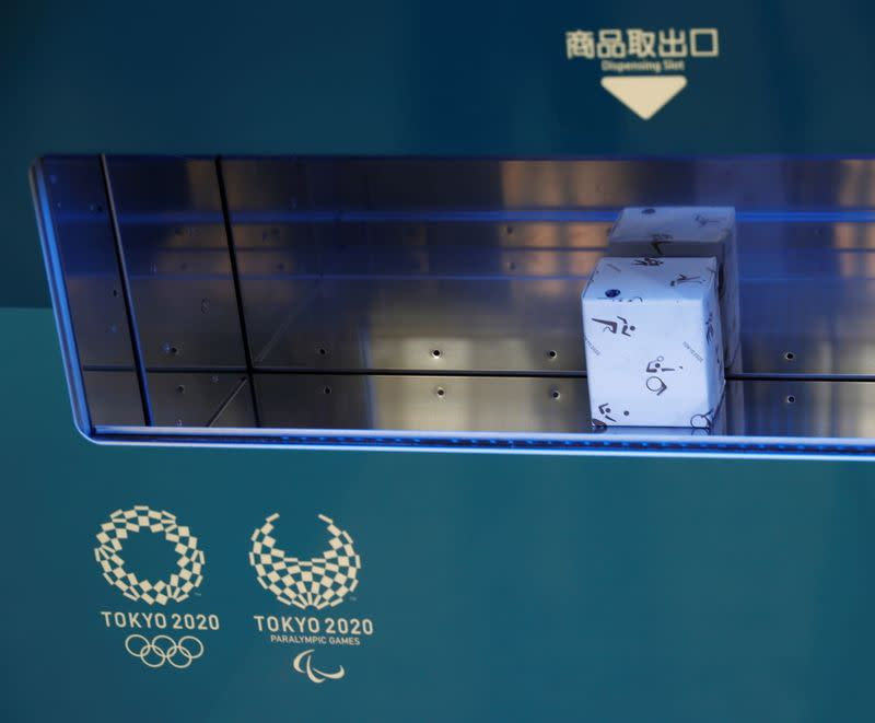 A Tokyo 2020 souvenir is pictured after purchase from a vending machine at the Olympic Main Press Center in Tokyo