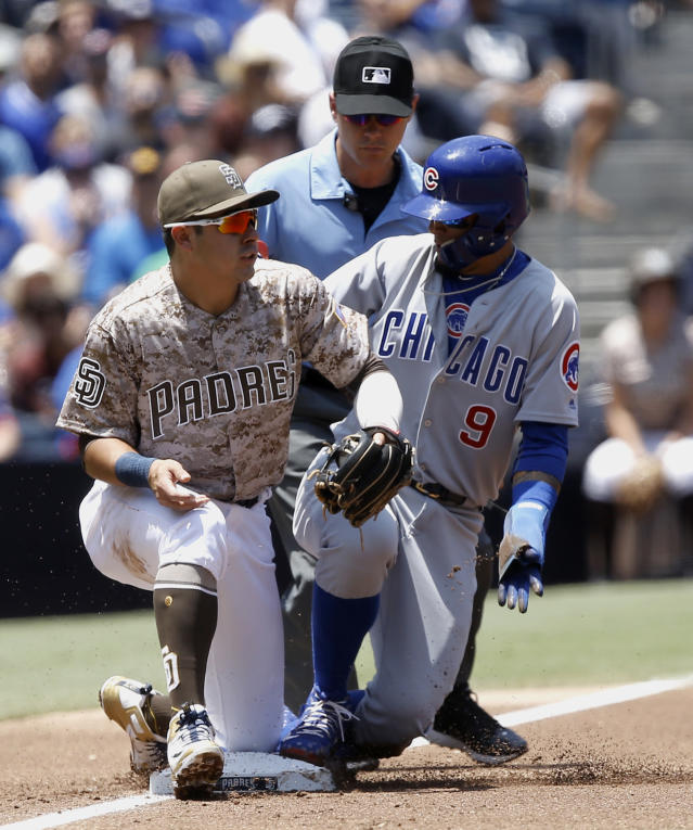 Chicago Cubs' Javier Baez, right, beats the throw to San Diego Padres third baseman Christian Villanueva, left, on a single by Addison Russell during the first inning of a baseball game in San Diego, Sunday, July 15, 2018. (AP Photo/Alex Gallardo)