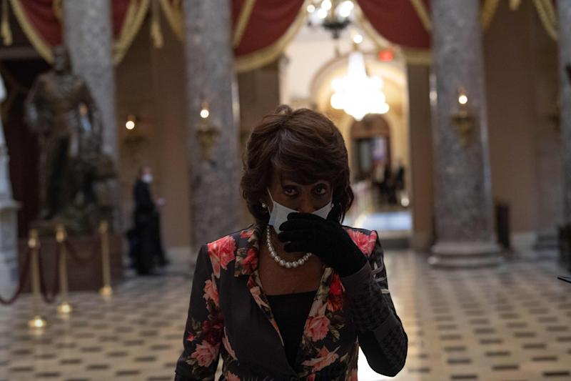 US Democratic Representative from California Maxine Waters walks out of the chamber of the US House of Representatives during the debate on the additional 484 billion dollar relief package amid the coronavirus pandemic at the US Capitol in Washington, DC, on April 23, 2020. (Photo by NICHOLAS KAMM / AFP) (Photo by NICHOLAS KAMM/AFP via Getty Images)