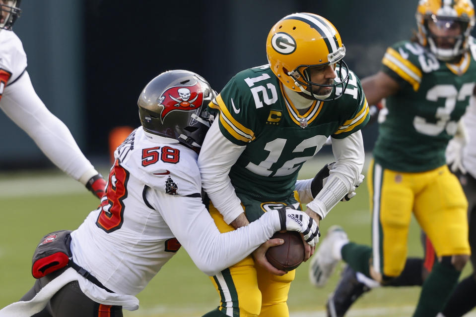 Buccaneers pass rusher Shaquil Barrett (58) sacks Packers quarterback Aaron Rodgers during Sunday's NFC championship game. (AP Photo/Jeffrey Phelps)