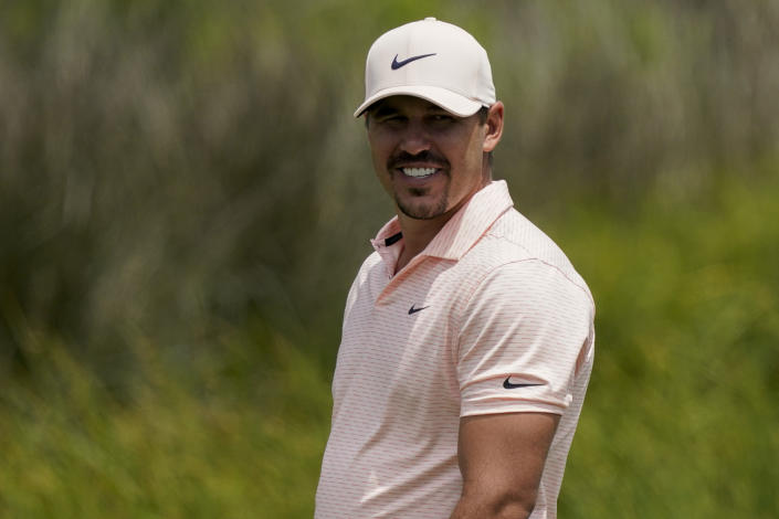 Brooks Koepka smiles on the 12th hole during a practice round at the PGA Championship golf tournament on the Ocean Course Tuesday, May 18, 2021, in Kiawah Island, S.C. (AP Photo/Matt York)