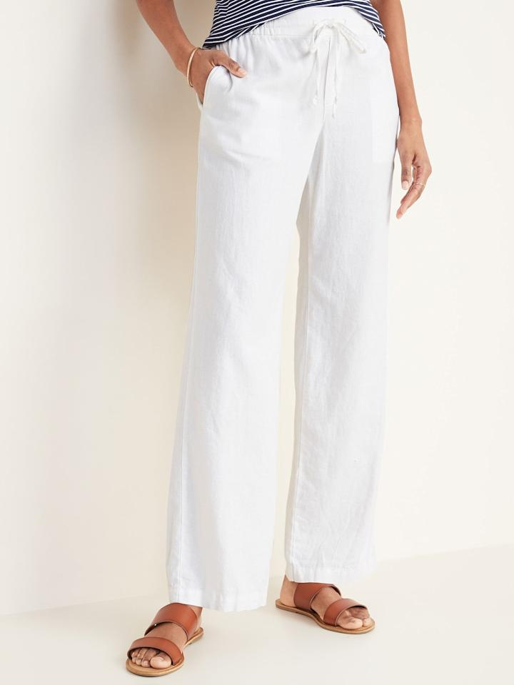 """<p>Headed on a tropical vacation? Snag these white <a href=""""https://www.popsugar.com/buy/Old-Navy-Mid-Rise-Wide-Leg-Linen-Blend-Pull--Pants-551921?p_name=Old%20Navy%20Mid-Rise%20Wide-Leg%20Linen-Blend%20Pull-On%20Pants&retailer=oldnavy.gap.com&pid=551921&price=35&evar1=fab%3Aus&evar9=47254489&evar98=https%3A%2F%2Fwww.popsugar.com%2Ffashion%2Fphoto-gallery%2F47254489%2Fimage%2F47256322%2FOld-Navy-Mid-Rise-Wide-Leg-Linen-Blend-Pull-On-Pants-in-Bright-White&list1=old%20navy%2Cpants%2Ctravel%20style%2Cspring%20fashion%2Cfashion%20shopping&prop13=mobile&pdata=1"""" rel=""""nofollow"""" data-shoppable-link=""""1"""" target=""""_blank"""" class=""""ga-track"""" data-ga-category=""""Related"""" data-ga-label=""""https://oldnavy.gap.com/browse/product.do?pid=551156052&amp;cid=1061987&amp;pcid=5475&amp;vid=1&amp;grid=pds_135_314_1#pdp-page-content"""" data-ga-action=""""In-Line Links"""">Old Navy Mid-Rise Wide-Leg Linen-Blend Pull-On Pants</a> ($35, originally $40).</p>"""
