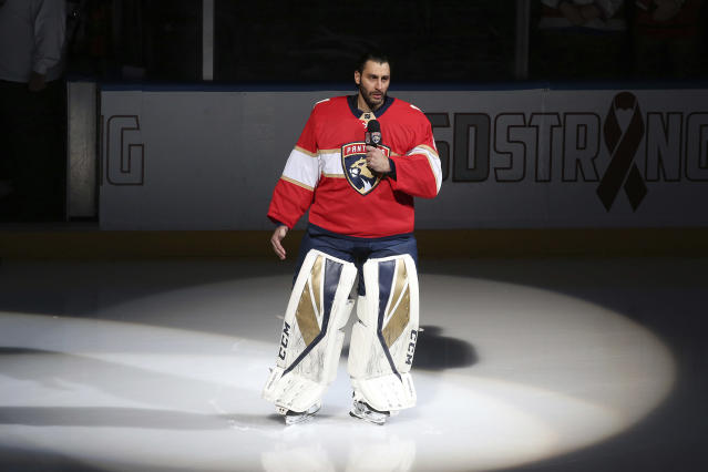 FILE - In this Thursday, Feb. 22, 2018, file photo, Florida Panthers goaltender Roberto Luongo (1) talks to fans about the shooting at Marjory Stoneman Douglas High School, prior to an NHL hockey game against the Washington Capitals, in Sunrise, Fla. A year after the shooting, the hearts of sports stars like Miami Heat guard Dwyane Wade and Florida Panthers goalie Roberto Luongo remain heavy. (AP Photo/Joel Auerbach, File)