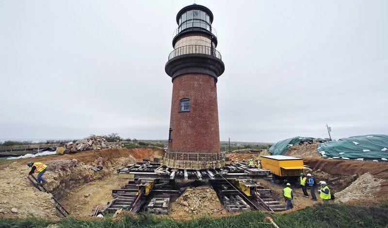A worker climbs out of a hole dug around the Gay Head Lighthouse while moving the historic structure in Aquinnah, Mass., on the island of Martha's Vineyard. The 160-year-old lighthouse took a multi-day trek to a new home slightly farther inland. The $3 million effort to move and save the structure was due to fear that it could tumble down a rapidly eroding cliffside.