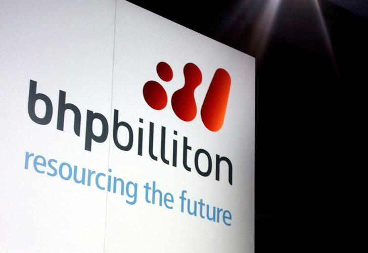 FILE PHOTO: A promotional sign adorns a stage at a BHP Billiton function in central Sydney