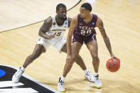 Texas Southern's Michael Weathers (20) moves the ball downcourt as Michigan's Chaundee Brown Jr. (15) defends during the first half of a First Round game in the NCAA men's college basketball tournament, Saturday, March 20, 2021, at Mackey Arena in West Lafayette, Ind. (AP Photo/Robert Franklin)