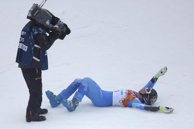 Slovenia's Tina Maze celebrates taking the lead in the second run of the women's giant slalom at the Sochi 2014 Winter Olympics, Tuesday, Feb. 18, 2014, in Krasnaya Polyana, Russia. (AP Photo/Charlie Riedel)