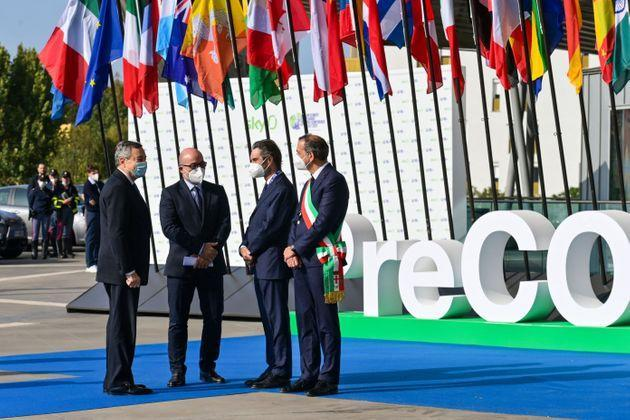 (From L) Italy's Prime Minister, Mario Draghi, Italy's Minister for Ecology Transition, Roberto Cingolani, President of the Lombardy region, Attilio Fontana and Milan mayor Giuseppe Sala arrive to attend the Pre-COP 26 summit at the Milan Conference Centre, MiCO, on September 30, 2021. - Each Conference of the Parties of the UN Framework Convention on Climate Change is preceded by a preparatory meeting held about a month before, called Pre-COP. Italy's Pre-COP brings together through September 30 - October 2 climate and energy ministers from a selected group of countries to discuss topics that will be addressed at COP26. (Photo by MIGUEL MEDINA / AFP) (Photo by MIGUEL MEDINA/AFP via Getty Images) (Photo: MIGUEL MEDINA via AFP via Getty Images)