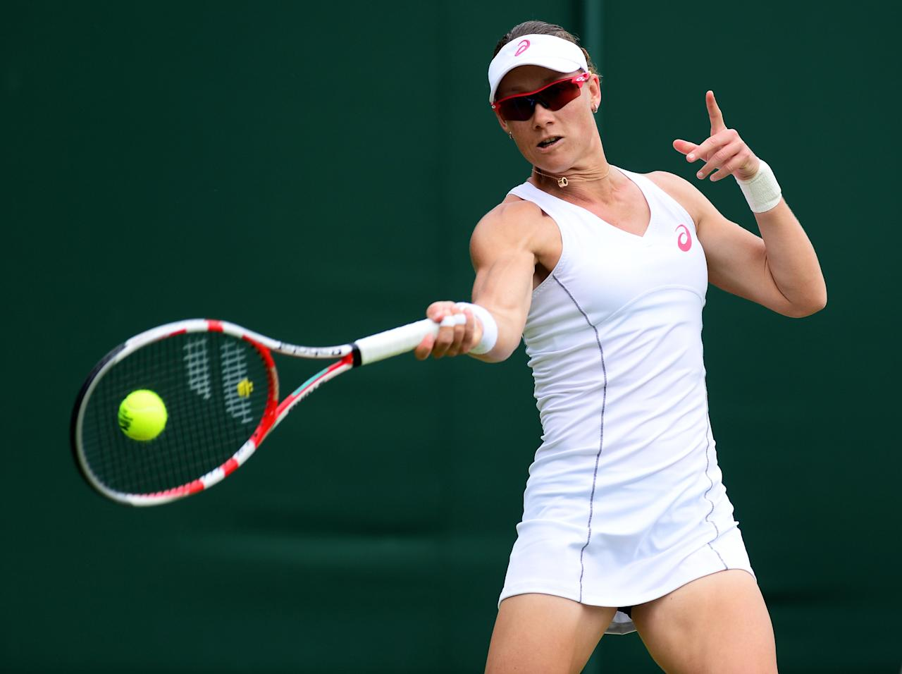 LONDON, ENGLAND - JUNE 27: Samantha Stosur of Australia plays a forehand during the Ladies' Singles second round match against Olga Puchkova of Russia on day four of the Wimbledon Lawn Tennis Championships at the All England Lawn Tennis and Croquet Club on June 27, 2013 in London, England. (Photo by Mike Hewitt/Getty Images)