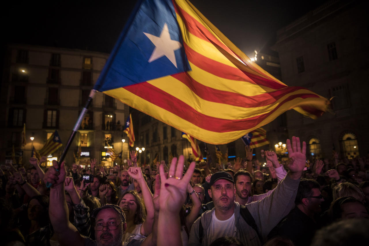"<p>Pro-independence supporters cheer and wave ""estelada"" or pro independence flags in the square outside the Palau Generalitat in Barcelona, Spain, after Catalonia's regional parliament passed a motion with which they say they are establishing an independent Catalan Republic, Friday, Oct. 27, 2017. (Photo: Santi Palacios/AP) </p>"