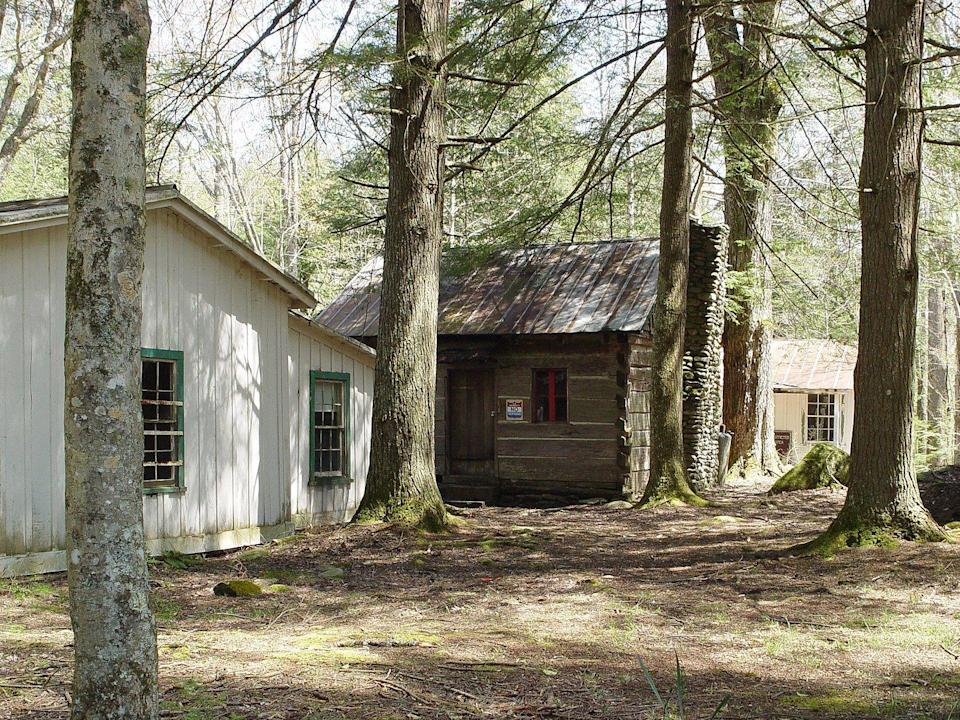 """<p><strong>Elkmont Historic District - Gatlinburg, TN</strong></p><p>Deep within the Great Smoky Mountains rests an abandoned resort community that was once home to a hotel, an Appalachian Clubhouse, and several single-family lodges. Parts of the little ghost town still exist, and <a href=""""https://www.cabinsusa.com/smoky-mountains-blog/post/17/10-haunted-places-in-the-smoky-mountains.php#PageContentTop"""" rel=""""nofollow noopener"""" target=""""_blank"""" data-ylk=""""slk:it's rumored"""" class=""""link rapid-noclick-resp"""">it's rumored</a> that the souls of those killed in horrific logging accidents still roam the village.</p><p>Photo: Wikimedia Commons/<a href=""""https://en.wikipedia.org/wiki/Elkmont%2C_Tennessee#/media/File:Trentham-cabin-elk.jpg"""" rel=""""nofollow noopener"""" target=""""_blank"""" data-ylk=""""slk:Steven C. Price"""" class=""""link rapid-noclick-resp"""">Steven C. Price</a></p>"""