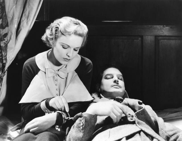 """Madeleine Carroll and Robert Donat on the set of """"The 39 Steps"""", directed by Alfred Hitchcock. (Photo by Sunset Boulevard/Corbis via Getty Images)"""