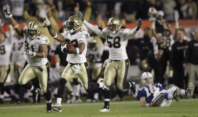 FILE - In this Feb. 7, 2010, file photo, New Orleans Saints cornerback Tracy Porter (22) reacts as he returns an interception 74 yards for a touchdown against the Indianapolis Colts during the second half of the NFL Super Bowl XLIV football game, in Miami. As part of its celebration of its 100th season, the NFL is designating a Game of the Week, each chosen to highlight a classic matchup. For this week, it is the Colts-Saints game. (AP Photo/Mike Groll, File)
