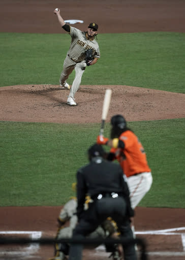 San Diego Padres starting pitcher Dinelson Lamet, top, throws to San Francisco Giants' Brandon Crawford during the first inning of the second game of a baseball doubleheader Friday, Sept. 25, 2020, in San Francisco. (AP Photo/Tony Avelar)
