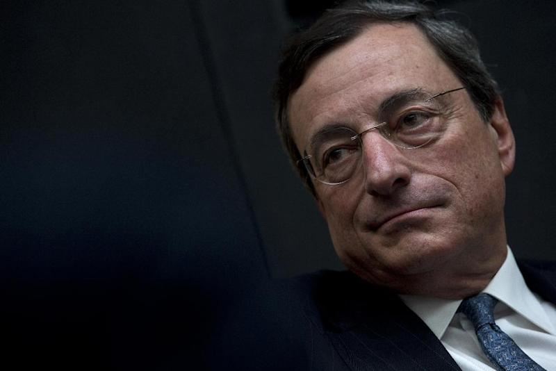 """European Central Bank President Mario Draghi listens to questions during a session of """"Room for Discussion"""" at the Faculty of Economics of the UvA, or University of Amsterdam, Netherlands, Monday April 15, 2013. (AP Photo/Peter Dejong)"""