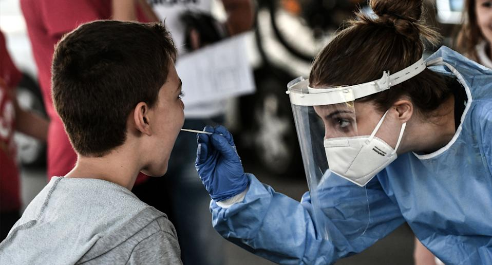 a young boy being tested for coronavirus