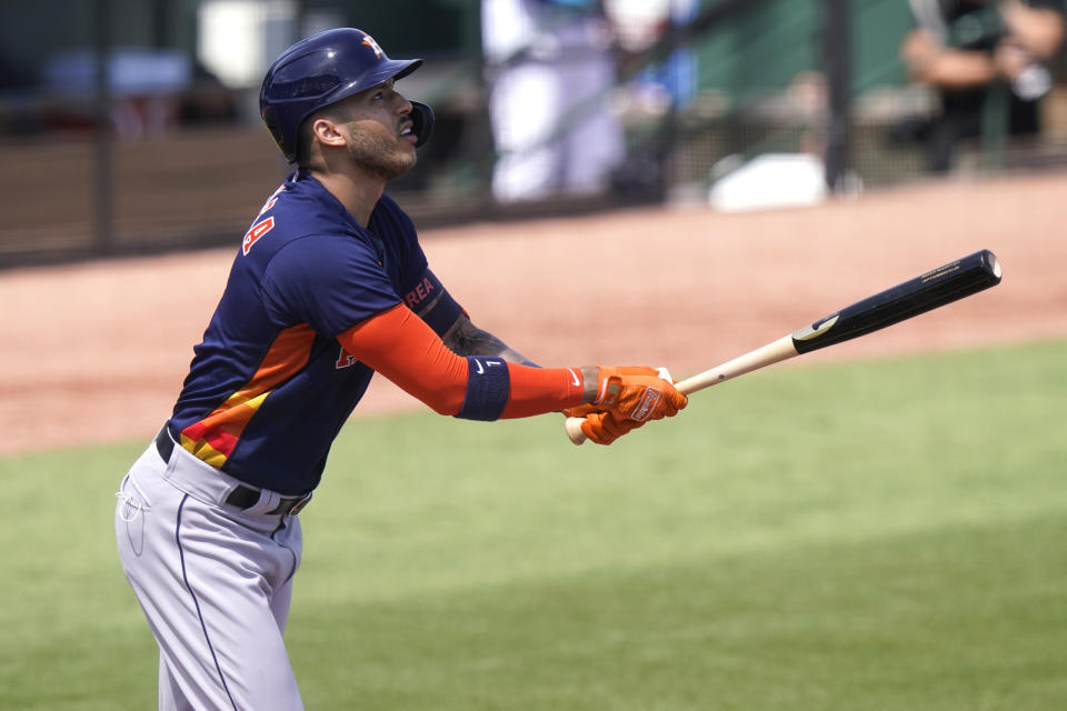 Houston Astros' Carlos Correa watches after fouling out during the first inning of a spring training baseball game against the Miami Marlins, Friday, March 5, 2021, in Jupiter, Fla. (AP Photo/Lynne Sladky)