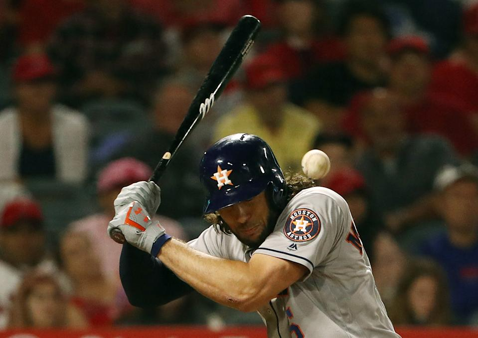 ANAHEIM, CALIFORNIA - JULY 16: Jake Marisnick #6 of the Houston Astros is hit by a pitch in the sixth inning of the MLB game against the Los Angeles Angels at Angel Stadium of Anaheim on July 16, 2019 in Anaheim, California. (Photo by Victor Decolongon/Getty Images)