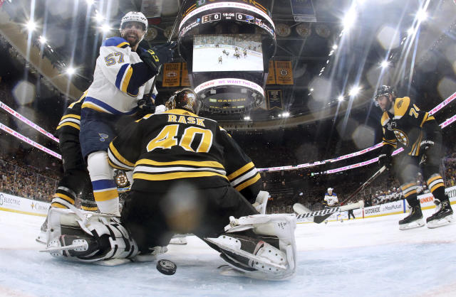 St. Louis Blues' David Perron, left, watches the puck shot by teammate Ryan O'Reilly sail through the legs of Boston Bruins goaltender Tuukka Rask, of Finland, for a goal during the second period in Game 5 of the NHL hockey Stanley Cup Final, Thursday, June 6, 2019, in Boston. (Bruce Bennett/Pool via AP)