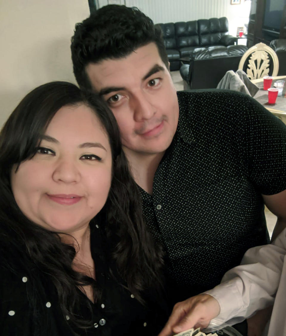 In this December 2019 photo provided by Mario Blancas, he and his sister Zelene Blancas pose at a Christmas party in El Paso, Texas. In 2018, a video Blancas posted of kids from her first grade class hugging each other as they left at the end of the day went viral on Twitter. She died of COVID-19 in December 2020. (Mario Blancas via AP)