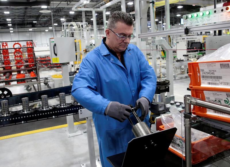 General Motors production worker Joseph Stanton works on the 10-speed transmission assembly at the General Motors (GM) Powertrain Transmission plant in Toledo, Ohio, U.S., March 6, 2019. Picture taken March 6, 2019. REUTERS/Rebecca Cook