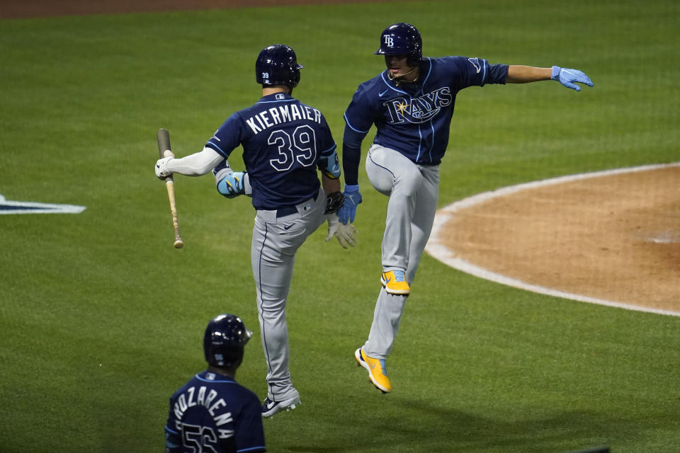 Tampa Bay Rays' Willy Adames, right, celebrates his solo home run with Kevin Kiermaier (39) during the fourth inning of a baseball game against the Los Angeles Angels Monday, May 3, 2021, in Anaheim, Calif. (AP Photo/Marcio Jose Sanchez)
