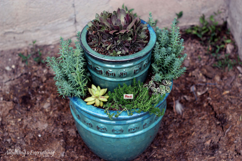 """<p>How many pots does it take to make a <a href=""""https://www.goodhousekeeping.com/home/gardening/how-to/a31912/tiered-planter-diy/"""" rel=""""nofollow noopener"""" target=""""_blank"""" data-ylk=""""slk:double-tiered planter"""" class=""""link rapid-noclick-resp"""">double-tiered planter</a>? You need three to create an impressive stacked container garden that is much more than the sum of its parts.</p><p><a href=""""http://www.myanythingandeverything.com/succulent-planter/"""" rel=""""nofollow noopener"""" target=""""_blank"""" data-ylk=""""slk:Get the tutorial at Anything & Everything »"""" class=""""link rapid-noclick-resp""""><em>Get the tutorial at Anything & Everything »</em></a><br></p>"""