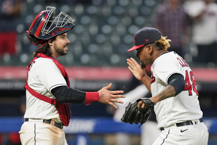 Cleveland Indians relief pitcher Emmanuel Clase, right, is congratulated by catcher Austin Hedges after the Indians defeated the Chicago White Sox 3-1 in the second baseball game of a doubleheader, Monday, May 31, 2021, in Cleveland. (AP Photo/Tony Dejak)