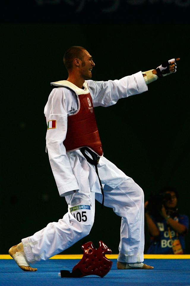 BEIJING - AUGUST 22: Mauro Sarmiento of Italy celebrates after winning the Men's Taekwondo 80kg Semifinal fight against Aaron Cook of Great Britain at the University of Science and Technology Beijing Gymnasium on Day 14 of the Beijing 2008 Olympic Games on August 22, 2008 in Beijing, China. (Photo by Quinn Rooney/Getty Images)