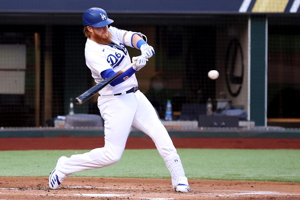 ARLINGTON, TEXAS - OCTOBER 13:  Justin Turner #10 of the Los Angeles Dodgers swings at a pitch against the Atlanta Braves during the first inning in Game Two of the National League Championship Series at Globe Life Field on October 13, 2020 in Arlington, Texas. (Photo by Joseph Israwi/Getty Images)