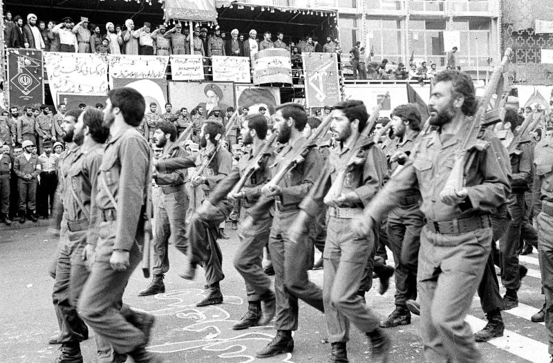 "FILE - In this May 16, 1983 file photo, the newly established Islamic Revolutionary Guards Corps parade past the viewing stand in Tehran, Iran. On Monday, April 8, 2019, the Trump administration designated Iran's Revolutionary Guard a ""foreign terrorist organization"" in an unprecedented move against a national armed force. Iran's Revolutionary Guard Corps went from being a domestic security force with origins in the 1979 Islamic Revolution to a transnational fighting force. (AP Photo, File)"