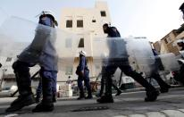 FILE PHOTO: Riot police patrol streets near British embassy prior to anti-government protest in support of Bahraini human rights activist Abdulhadi al-Khawaja in Manama