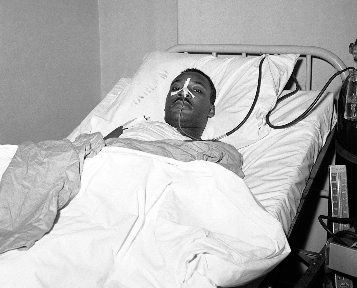 Martin Luther King Jr. recovers from surgery in bed at New York's Harlem Hospital following an operation to remove steel letter opener from his chest after being stabbed by a mentally disturbed woman, Sept. 21, 1958. (Photo: John Lent/AP)