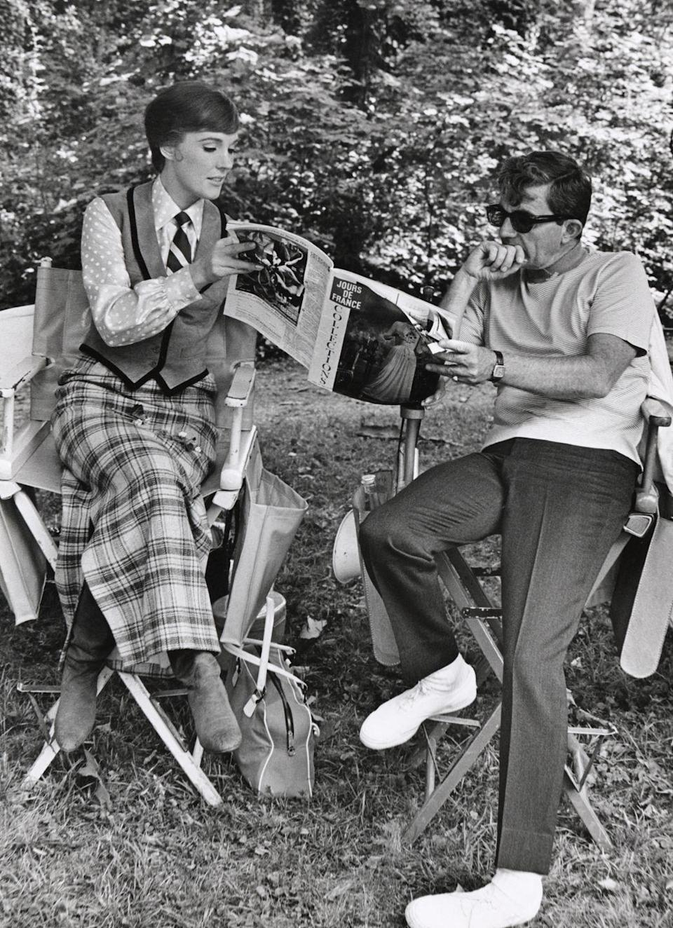 <p>On the set of <em>Darling Lilies </em>director Blake Edwards shares a magazine with his future wife, and lead actress of the film, Julie Andrews. </p>