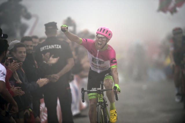 Canada's Michael Woods celebrates after winning the 17th stage of the Spanish Vuelta cycling race between Getxo and Balcon de Vizcaya, northern Spain, Wednesday, Sept.12, 2018. (AP Photo/Alvaro Barrientos)
