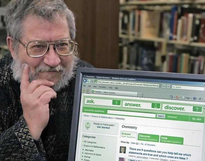 Richard Marchal contemplates an answer to a question submitted online at a local library, Thursday, Dec. 28, 2006, in Marion, Ill. Marchal, a semi-retired chemist and father of five, is the top-rated answerer on Yahoo! Answers, a Web site where people pose questions and hope that strangers will answer them. (AP Photo/Tom Gannam)