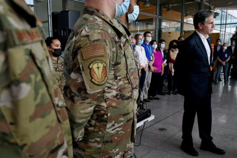 US Secretary of State Antony Blinken speaks with evacuation operations staff at Ramstein Air Base in Germany (AFP/Olivier DOULIERY)