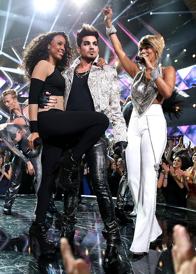 """LOS ANGELES, CA - DECEMBER 16: (L-R) Singers Kelly Rowland, Adam Lambert and Keri Hilson perform onstage during """"VH1 Divas"""" 2012 at The Shrine Auditorium on December 16, 2012 in Los Angeles, California. (Photo by Christopher Polk/Getty Images)"""