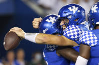 Kentucky quarterback Will Levis, right, hugs running back Chris Rodriguez Jr. (left) after winning an NCAA college football game against Florida in Lexington, Ky., Saturday, Oct. 2, 2021. (AP Photo/Michael Clubb)