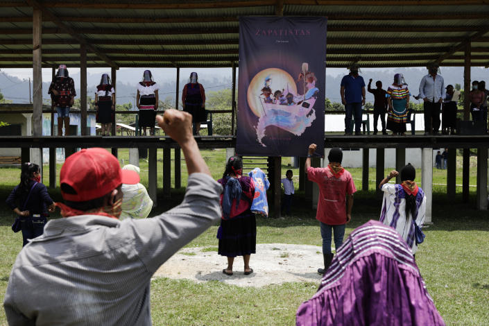 Members of the Zapatista Army of National Liberation, EZLN, bid farewell to a delegation that will leave for Europe on May 3, in the community of Morelia, Chiapas state, Mexico, Monday, April 26, 2021. The rebels say they are planning to take canoes on a trip to 'invade' Spain in May and June, as Mexico marks the anniversary of the 1519-1521 Spanish Conquest of Mexico. (AP Photo/Eduardo Verdugo)